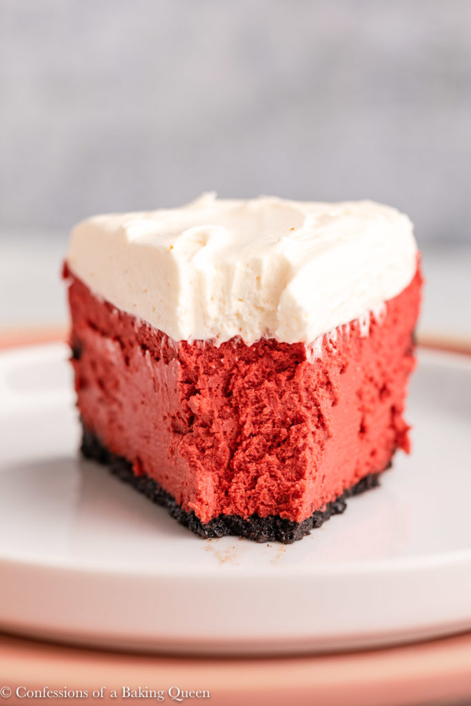 slice of red velvet cheesecake with a bit taken out