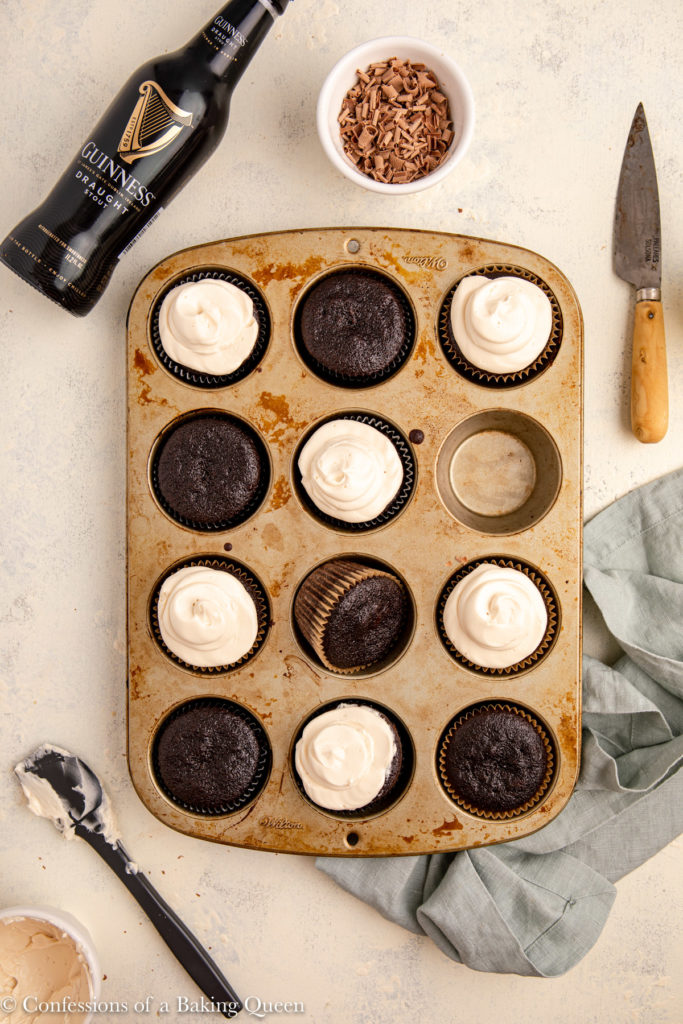 Guinness chocolate cupcakes in pan some frosted