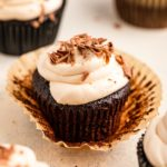 baileys frosted guinness chocolate cupcakes on a white surface