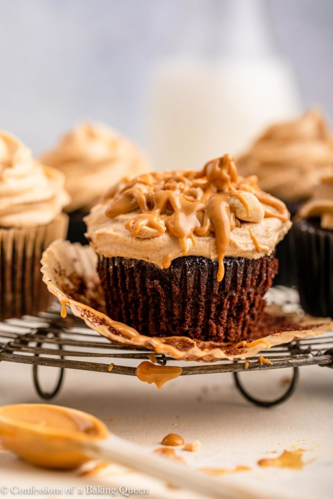chocolate cupcake frosted with peanut butter icing and nuts