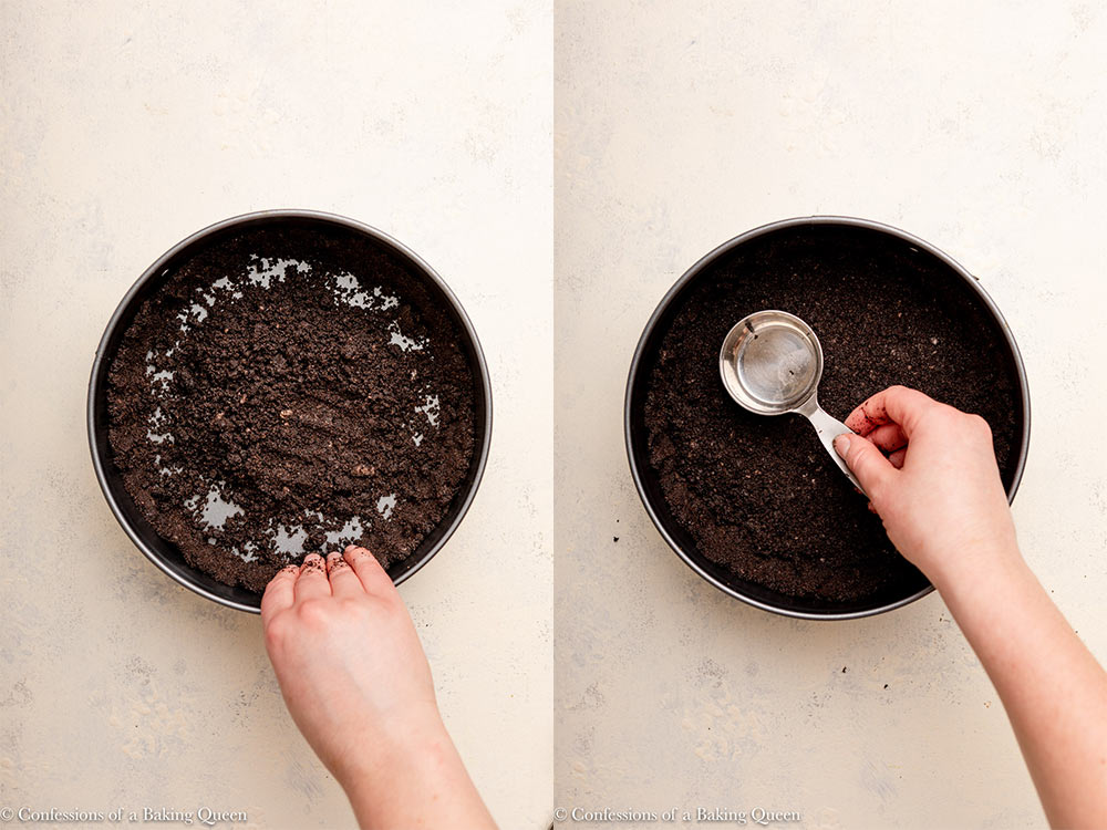 hand pressing oreo cookie crumbs into a springform pan