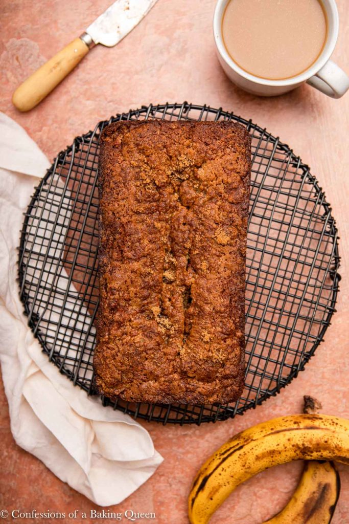 loaf of almond flour banana bread on a black wire rack