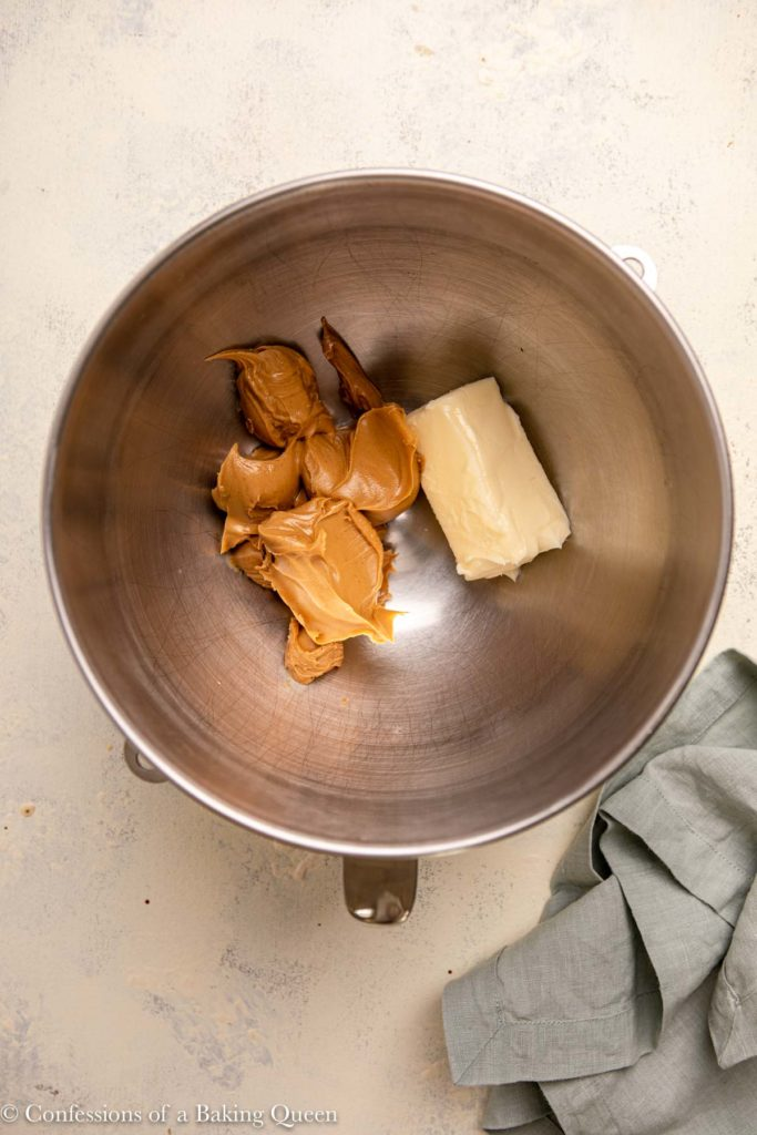 peanut butter and butter in a metal mixing bowl