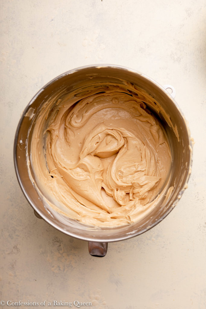 peanut butter cheesecake batter in a metal mixing bowl