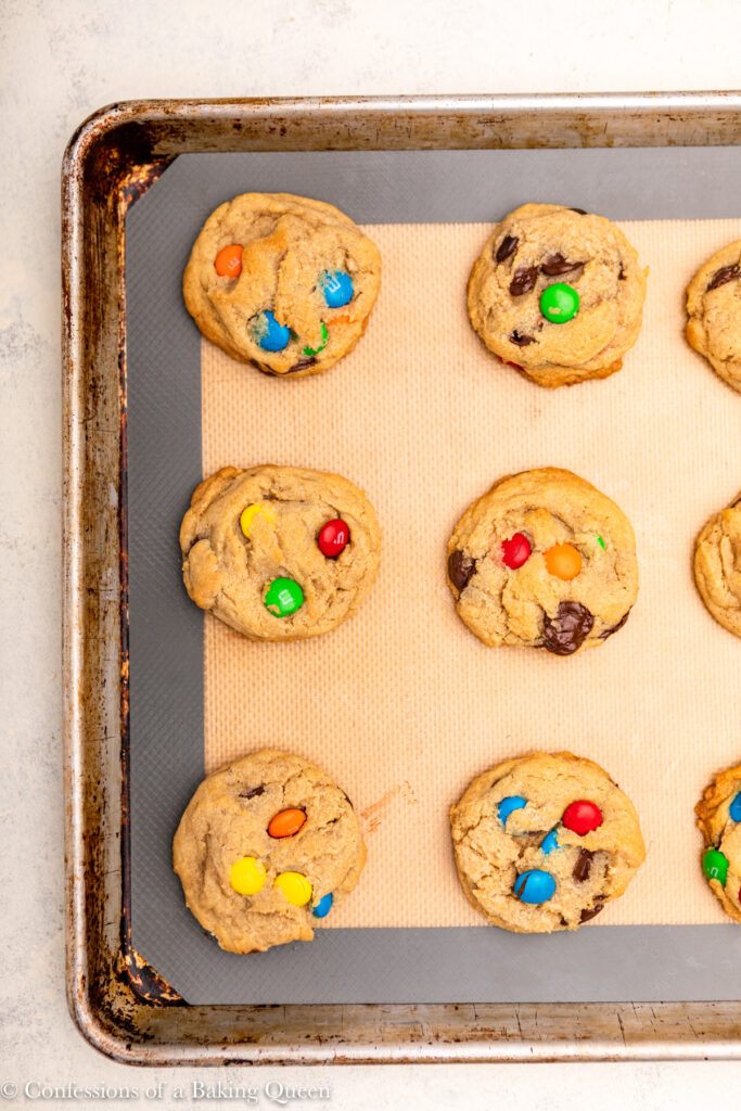 baking tray with freshly baked m&M cookies on