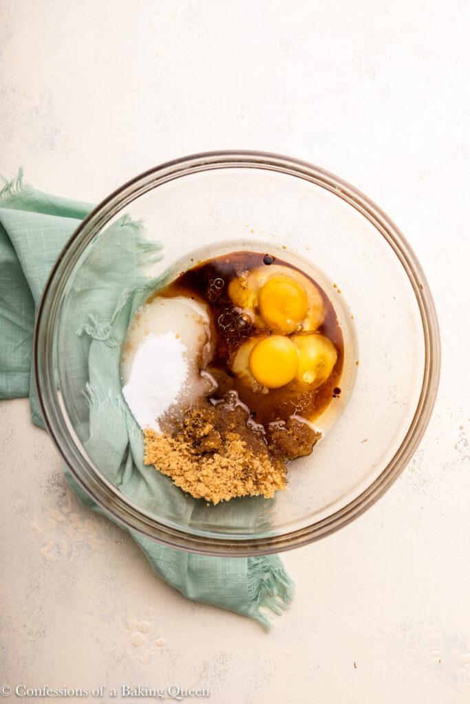 eggs, sugar, oil, and vanilla in a glass bowl