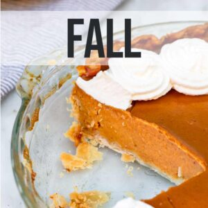 pumpkin pie in a glass dish with a slice missing