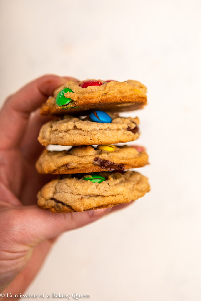 hand holding 4 m&M cookies