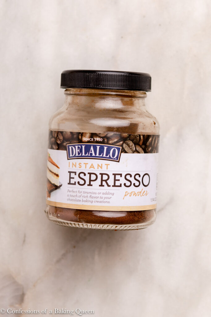 jar of delallo instant espresso powder on a marble surface