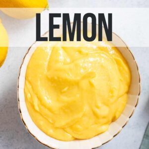 bowl of lemon curd next to lemons