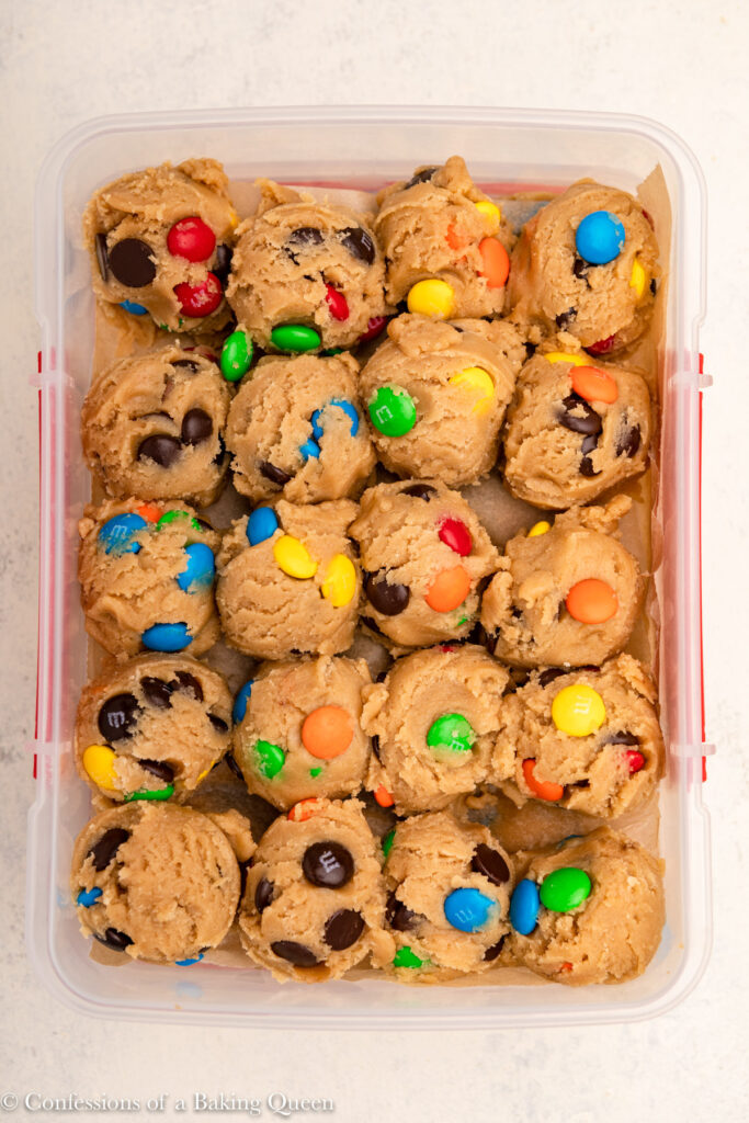 m&ms cookie dough balls in a plastic container