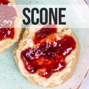 scone with clotted cream and jam on a light blue plate