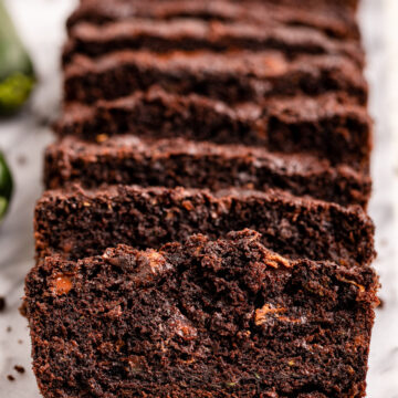 slices of double chocolate zucchini cake on a marble slab