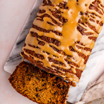 sticky toffee loaf cake cut open on a marble slab