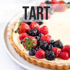 close up of lemon tart with fresh berries
