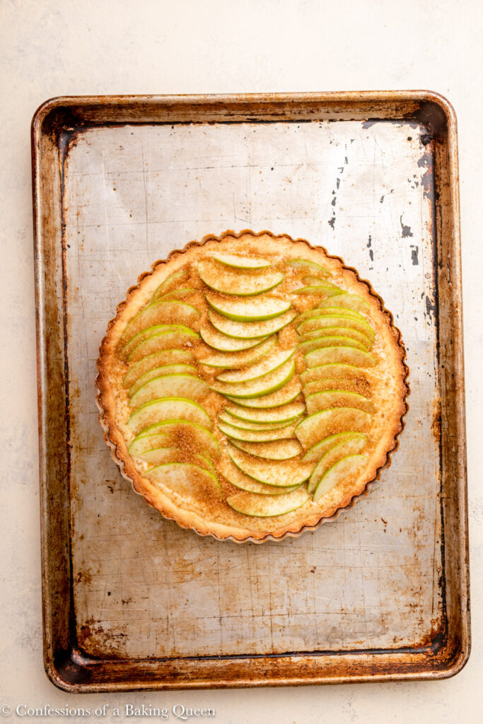 apple frangipane tart on a sheet tray before baking