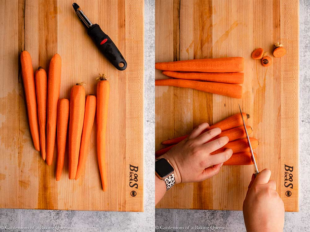 carrots peeled and stems cut off on a wood cutting board on a grey surface