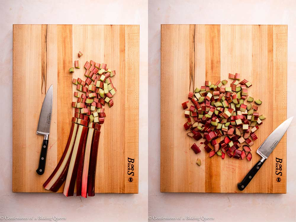 three rhubarb stalks chopped into small pieces with a large knife on a wood board on a pink surface