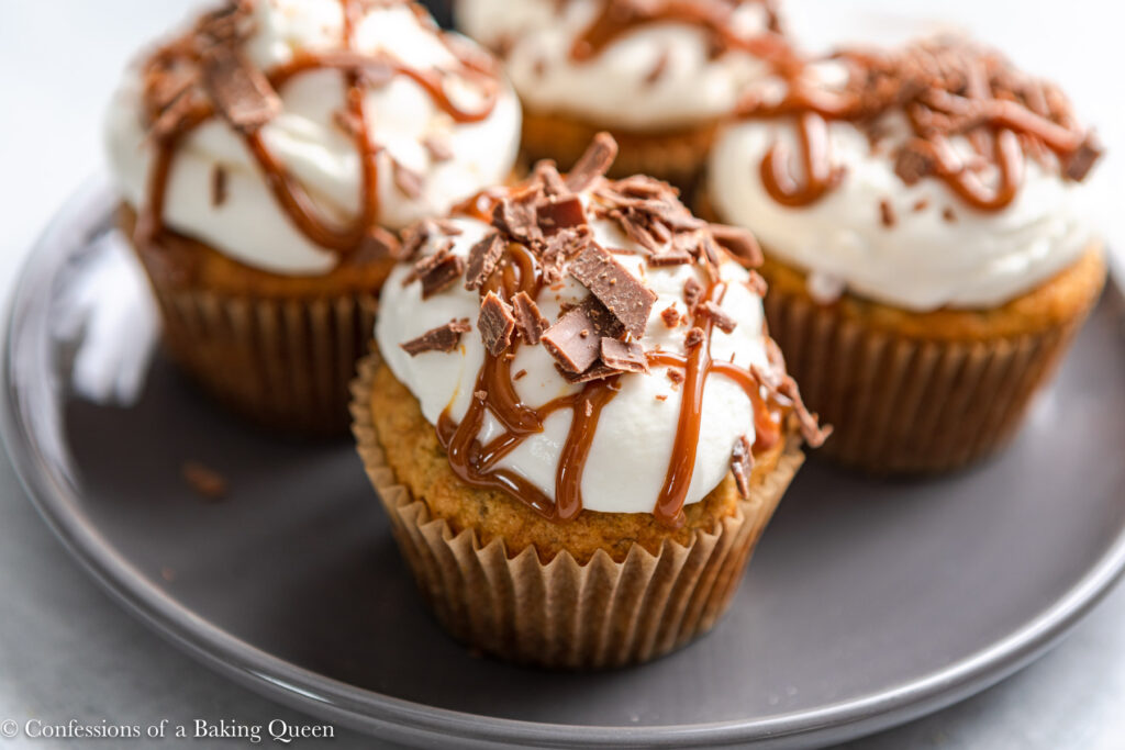 banoffee pie cupcakes on a grey plate on a grey surface