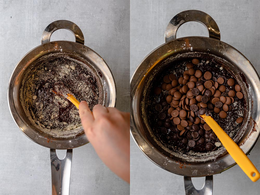 almond flour folded into brownie batter then chocolate chips added in a metal pot on a grey surface