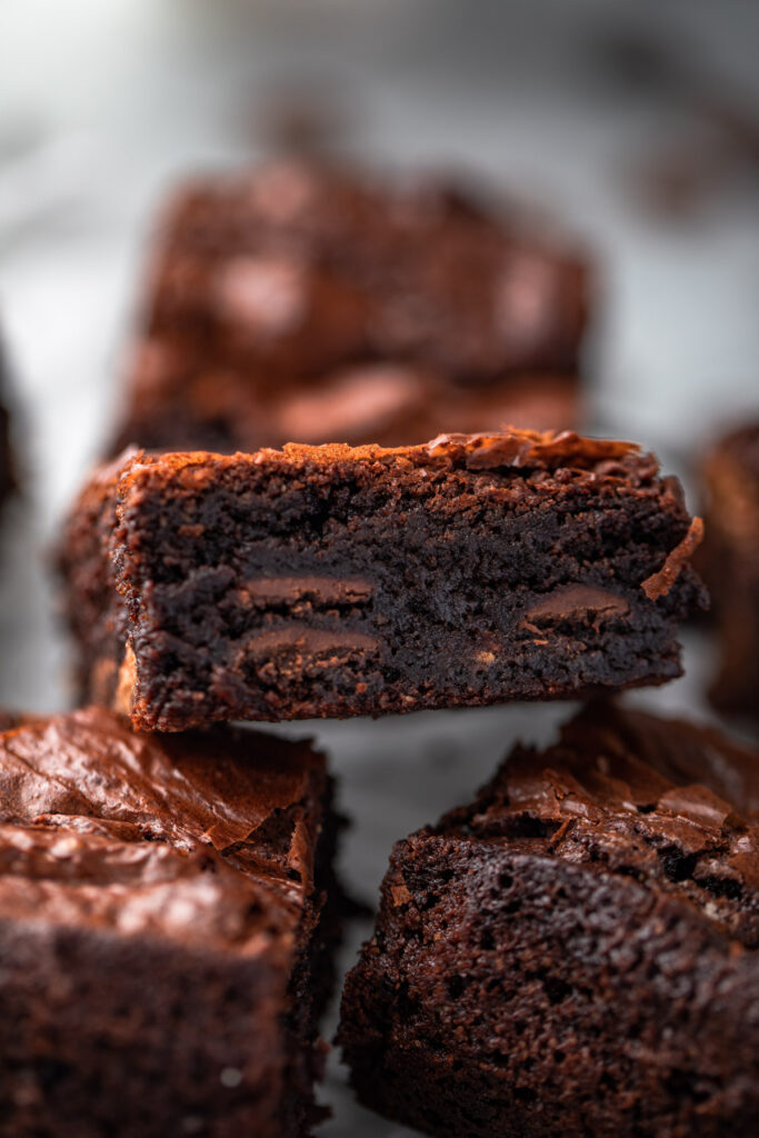 close up of almond flour brownies cut into bars on a wire rack