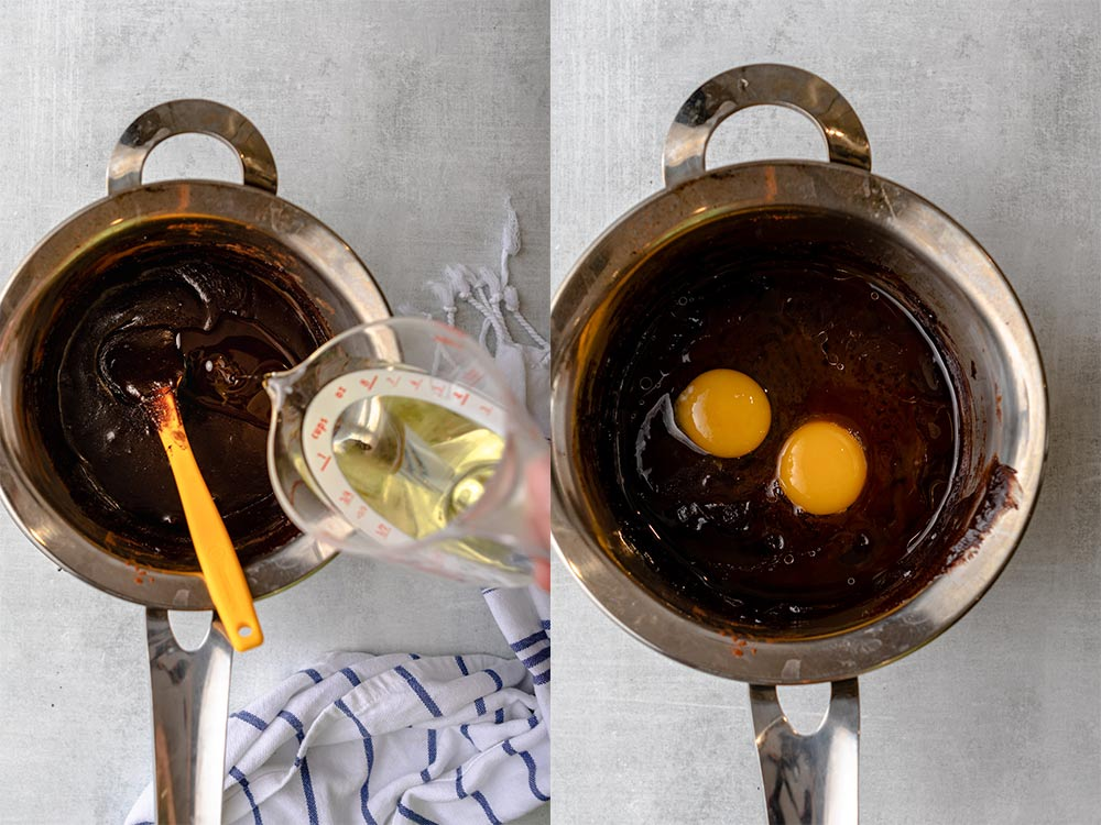 oil poured into brownie batter then eggs added to brownie batter in a metal pan on ag rey surface_