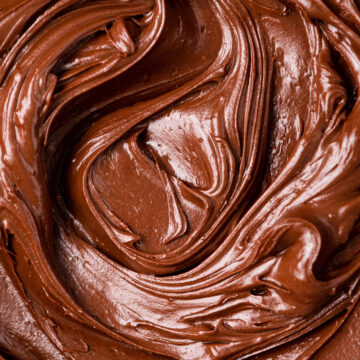 close up of chocolate frosting swirled together