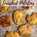 crispy smashed potatoes on a metal sheet pan
