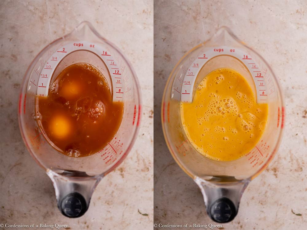 eggs and vanilla in a liquid measuring cup whisked together on a light brown surface