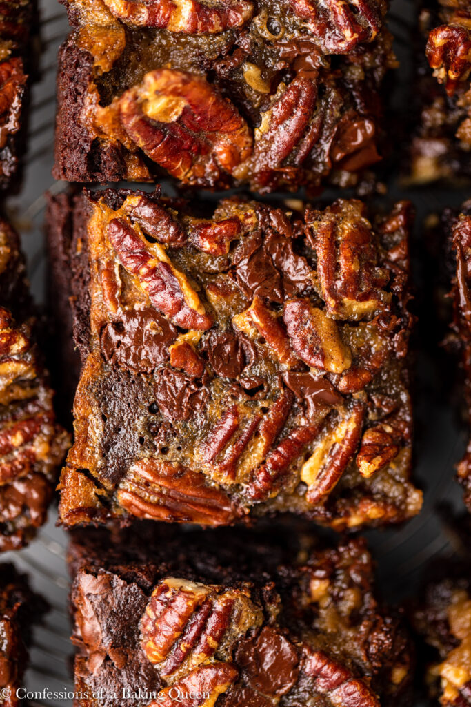 up close of pecan pie brownies on a wire rack