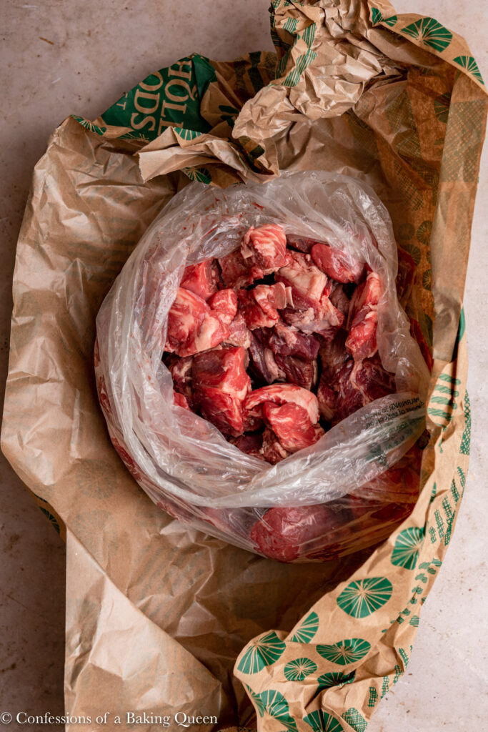 beef stew meat unwrapped from butcher paper