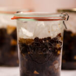 three jars of mincemeat on a marble surface