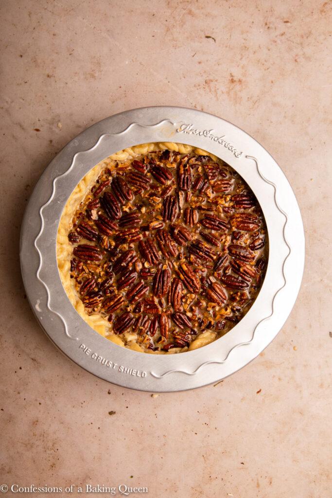 pie shield on top of pecan pie before baking