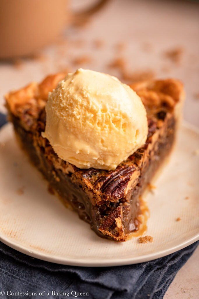 up close of slice of pecan pie with vanilla ice cream