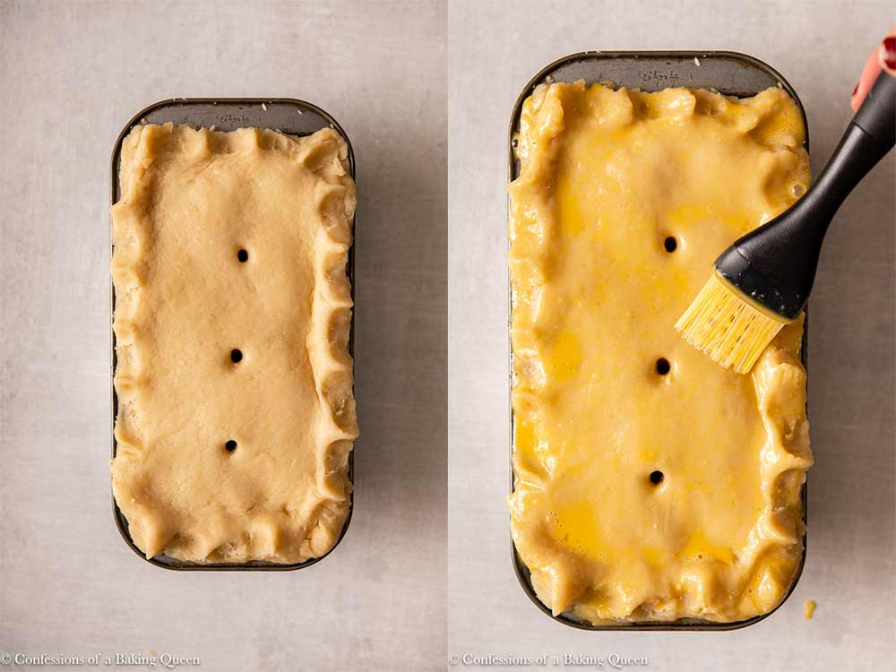 top crust put on pork pie with an egg wash brushed on top before baking in a loaf pan on a light grey surface