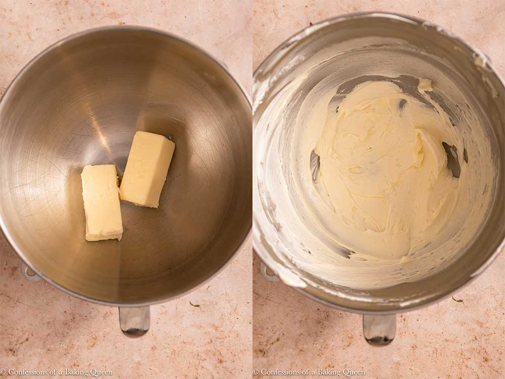 butter mixed to a light fluffy mixture in a metal bowl on a light brown surface