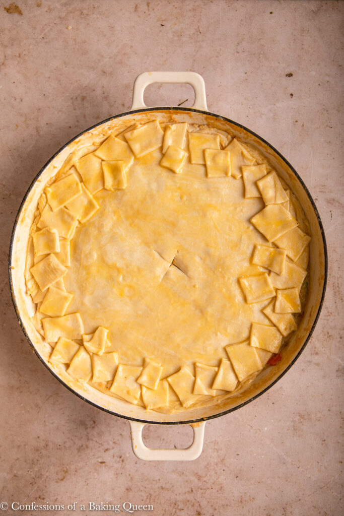 chicken pie before baking on a light brown surface