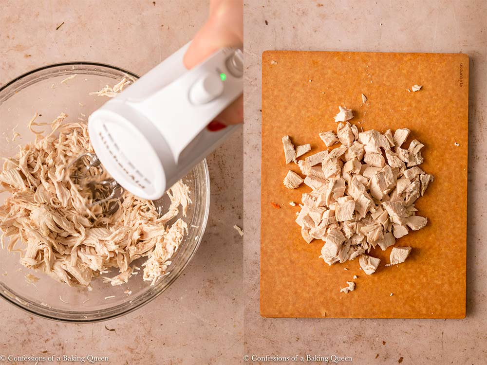 hand mixer shredding chicken and chicken chopped on a cutting board on a light brown surface
