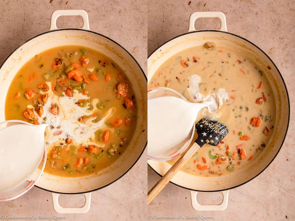 milk slowly poured into chicken broth and veggies in a white skillet on a light brown surface