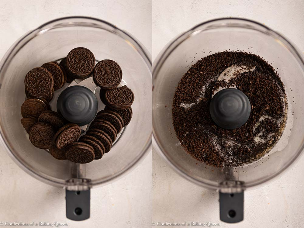 oreos crushed with melted butter added in a food processor on a grey surface