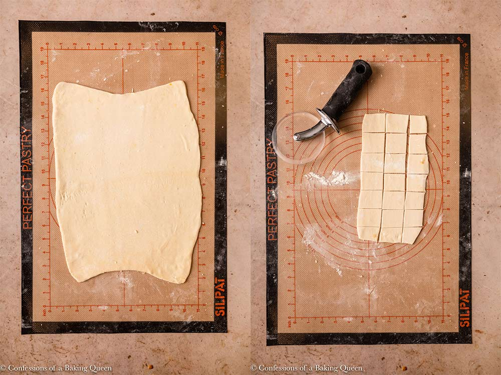 puff pastry rolled out and then cut into squares on a silpat worksurface on a light brown surface