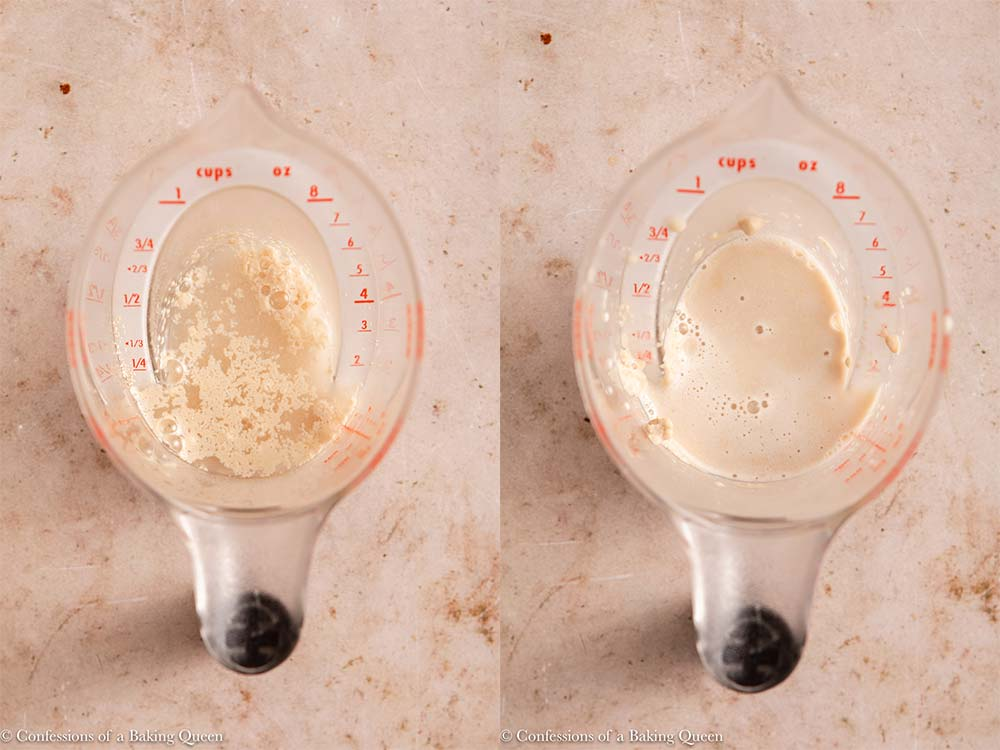 yeast activated in water in a liquid measuring cup on a light brown surface