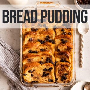 bread pudding on top of a light blue towel with a serving spoon