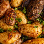 close up of roasted fingerling potatoes tossed with fresh parsley