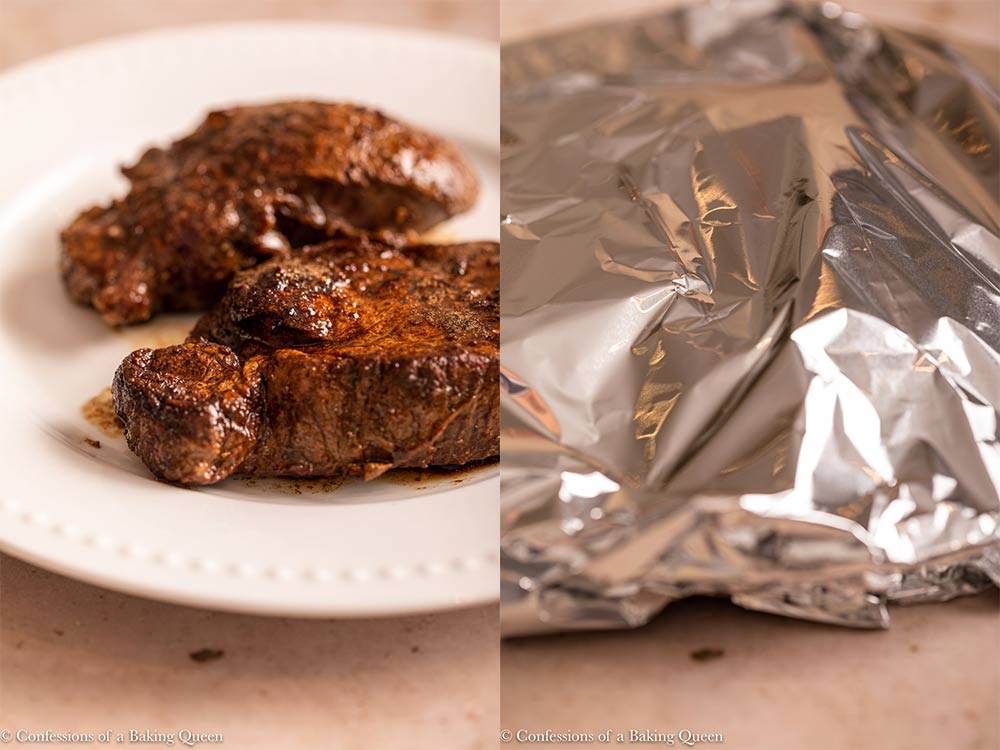 filet mignon resting on a white plate covered in foil to rest on a light brown background
