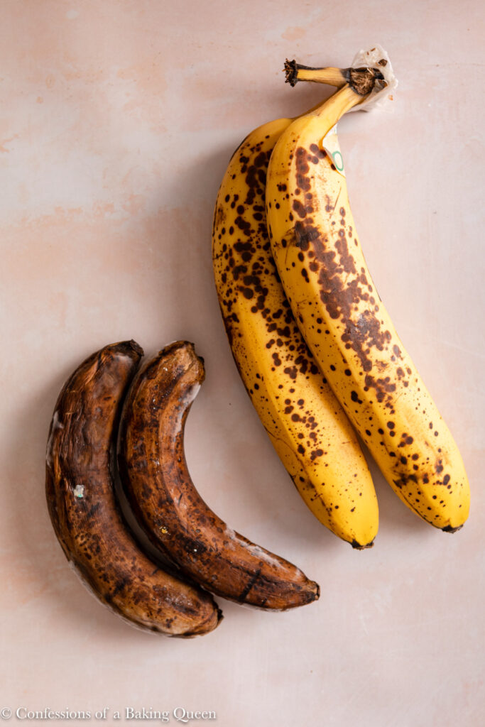 four spotty bananas on a light pink surface