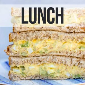stack of egg salad sandwiches on a blue plate