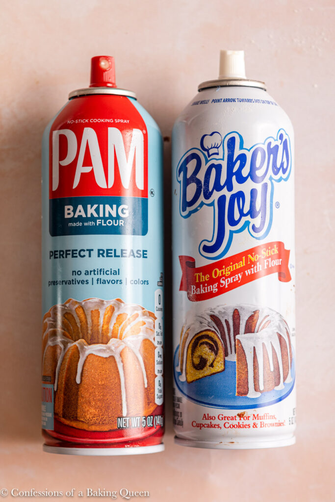 two baking spray cans on a light pink surface