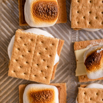 close up of smores on a metal cookie tray
