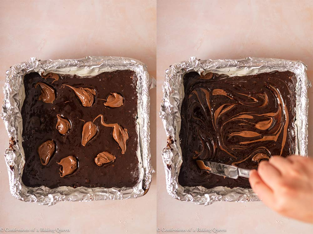 dollops of nutella swirled into brownie batter before baking inside a foil lined square pan on a light pink surface